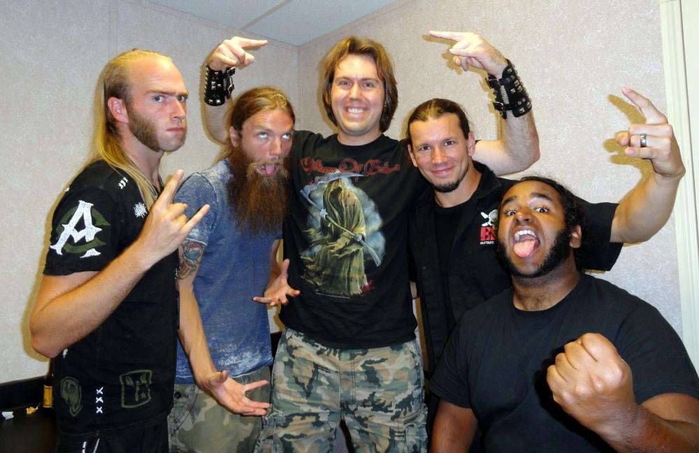 Damnation Magazine staff writer Matt Albers (center) with Battlecross.