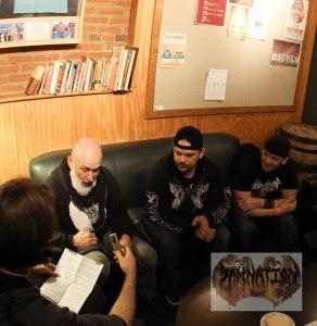 """Matt Albers interviewing Byzantine at The Schalfly Tap Room. Left to right: Chris """"OJ"""" Ojeda (vocals, rhythm guitar), Matt Wolfe (drums), Sean Sydnor (bass)."""