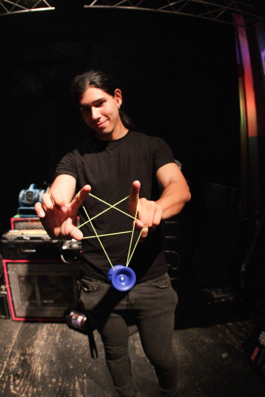 Alex Lee (guitar) of Holy Grail displaying his metal yo-yoing skills.