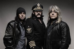 "Motörhead lineup [left to right]: Phil ""Wizzo"" Campbell (guitar, backing vocals), Ian ""Lemmy"" Kilmister (lead vocals, bass guitar), Mikky Dee (drums)"