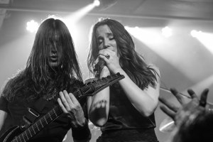 Mark Jansen (left - rhythm guitar, growls/screams; 2002-present) and Simone Simons (right - lead vocals; 2002-present) of Epica, live at The Ready Room in St. Louis, MO - photo credit: Nick Licata [2016]
