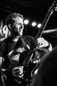 Adam Carroll (guitar, 2004 – 2012, 2012 - present) of Warbringer, live at Fubar in St. Louis, MO - image credit: Nick Licata (2016)